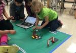 Image of students with We Do Lego Robots