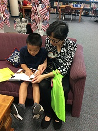 Parent reading with student